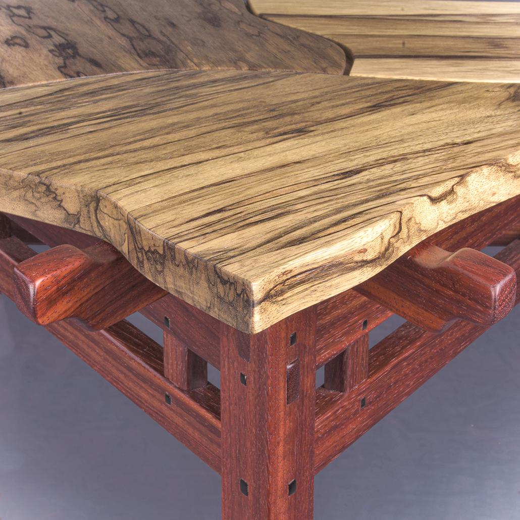 One corner of the Tercet Leaf Table