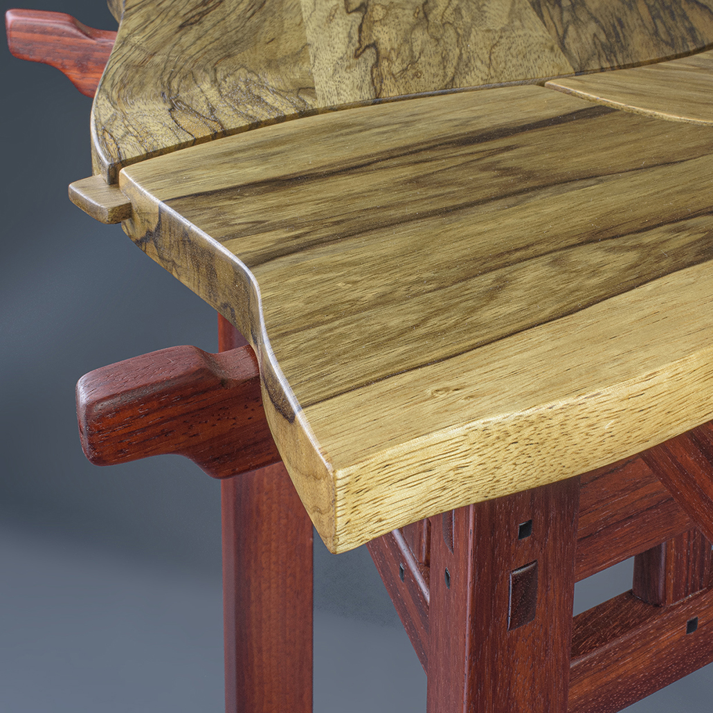 Close up of the top of the Tercet Leaf Table.
